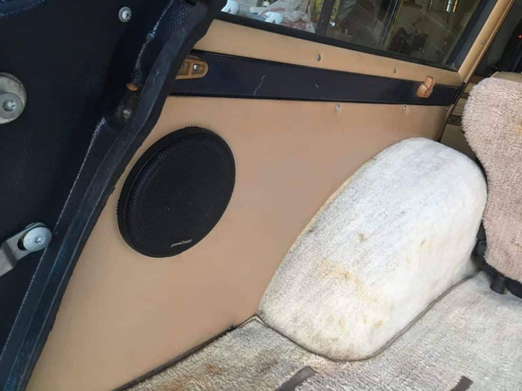 speaker, cargo area, vinyl wrapped pressboard, jeep grand wagoneer